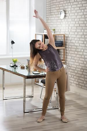 businesswoman, stretching - 22695955