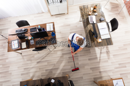 janitor, cleaning, floor, with, broom, in - 22695733