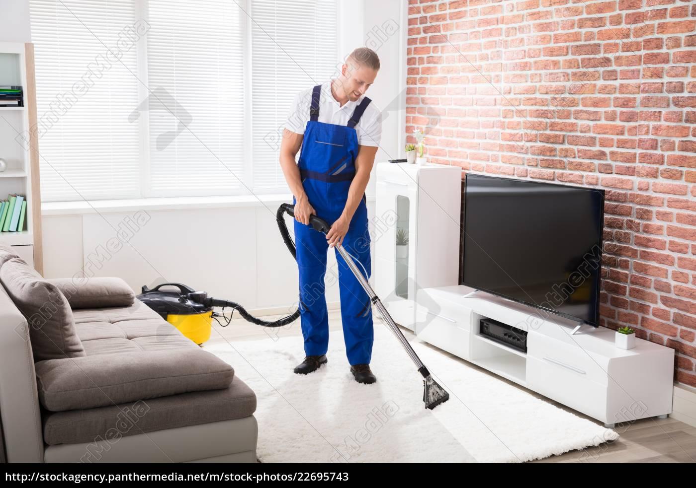 male, janitor, vacuuming, carpet - 22695743