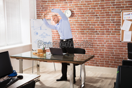 man, exercising, in, office - 22695649
