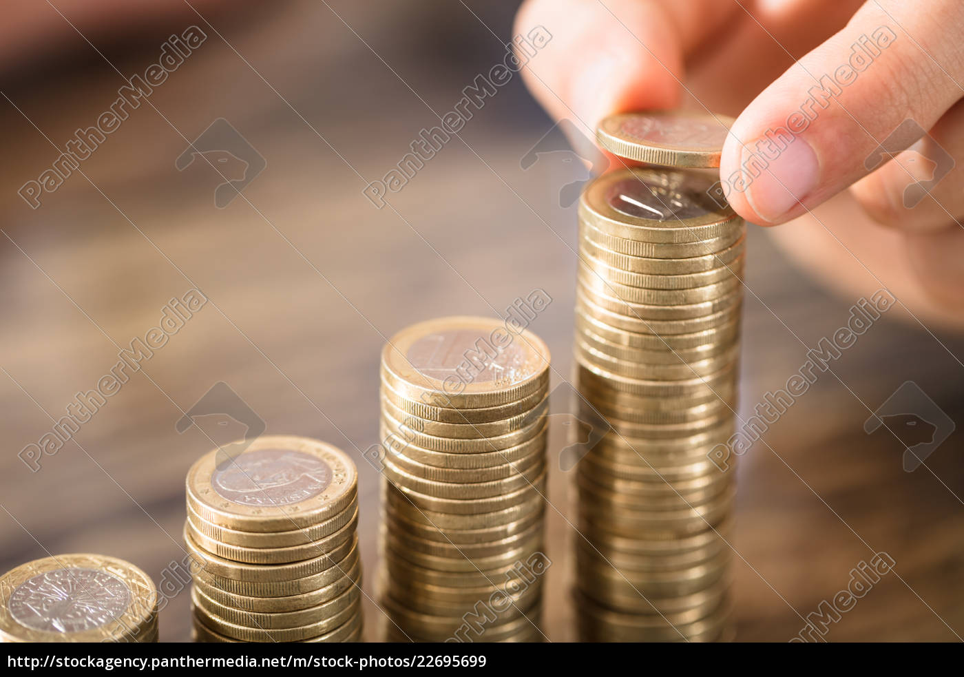 person, placing, coin, over, the, coins - 22695699
