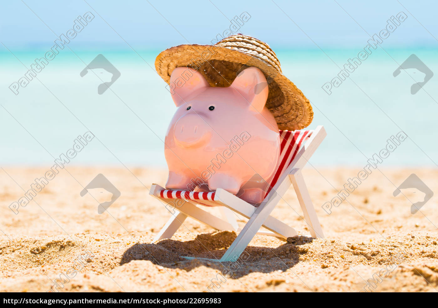 piggy, bank, with, straw, hat, over - 22695983