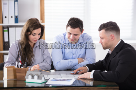 real, estate, agent, meeting, with, couple - 22695885