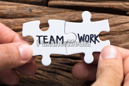 hands connecting team work jigsaw pieces