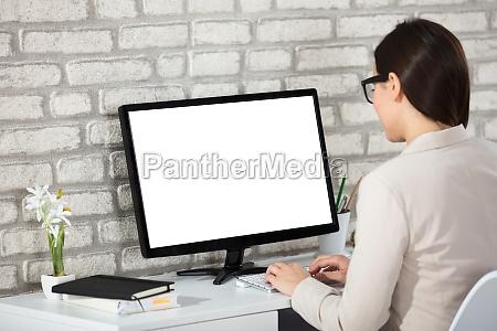 businesswoman using blank computer