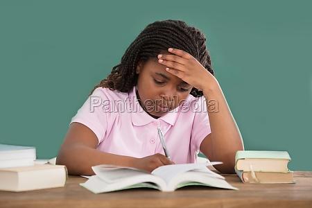 an, african, girl, doing, study - 22696051