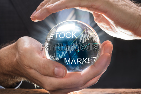 businessman, covering, crystal, ball, with, stock - 22696975