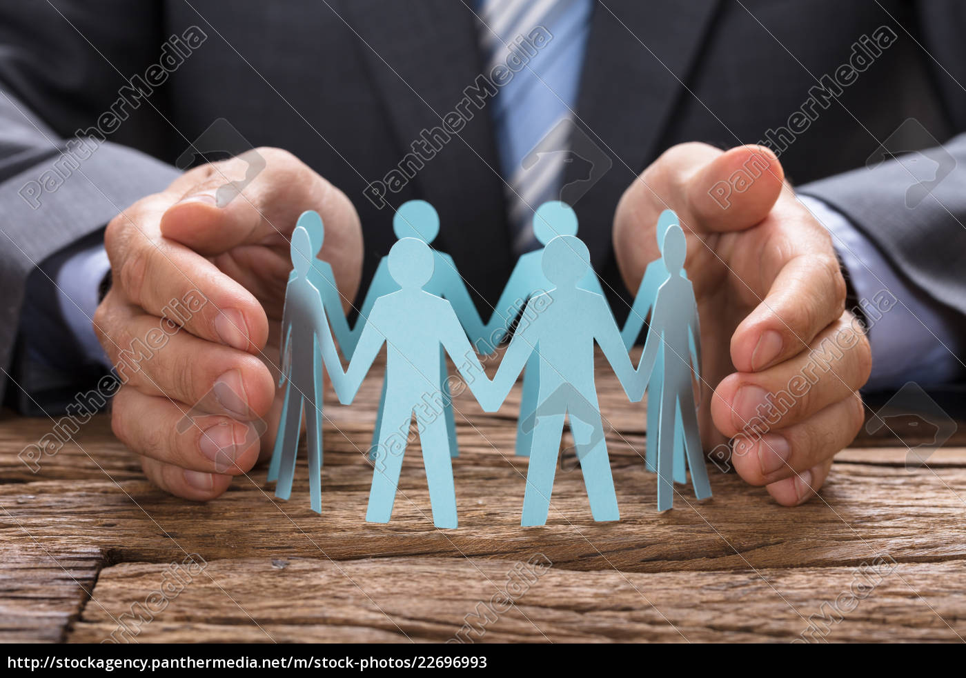 businessman, covering, paper, team, with, hands - 22696993