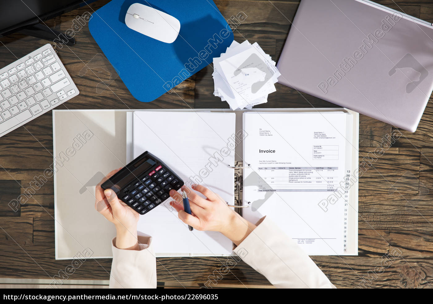 businesswoman, calculating, invoice, in, office - 22696035