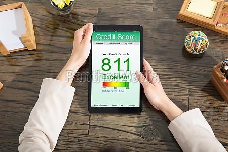 businesswoman, checking, online, credit, score - 22696043
