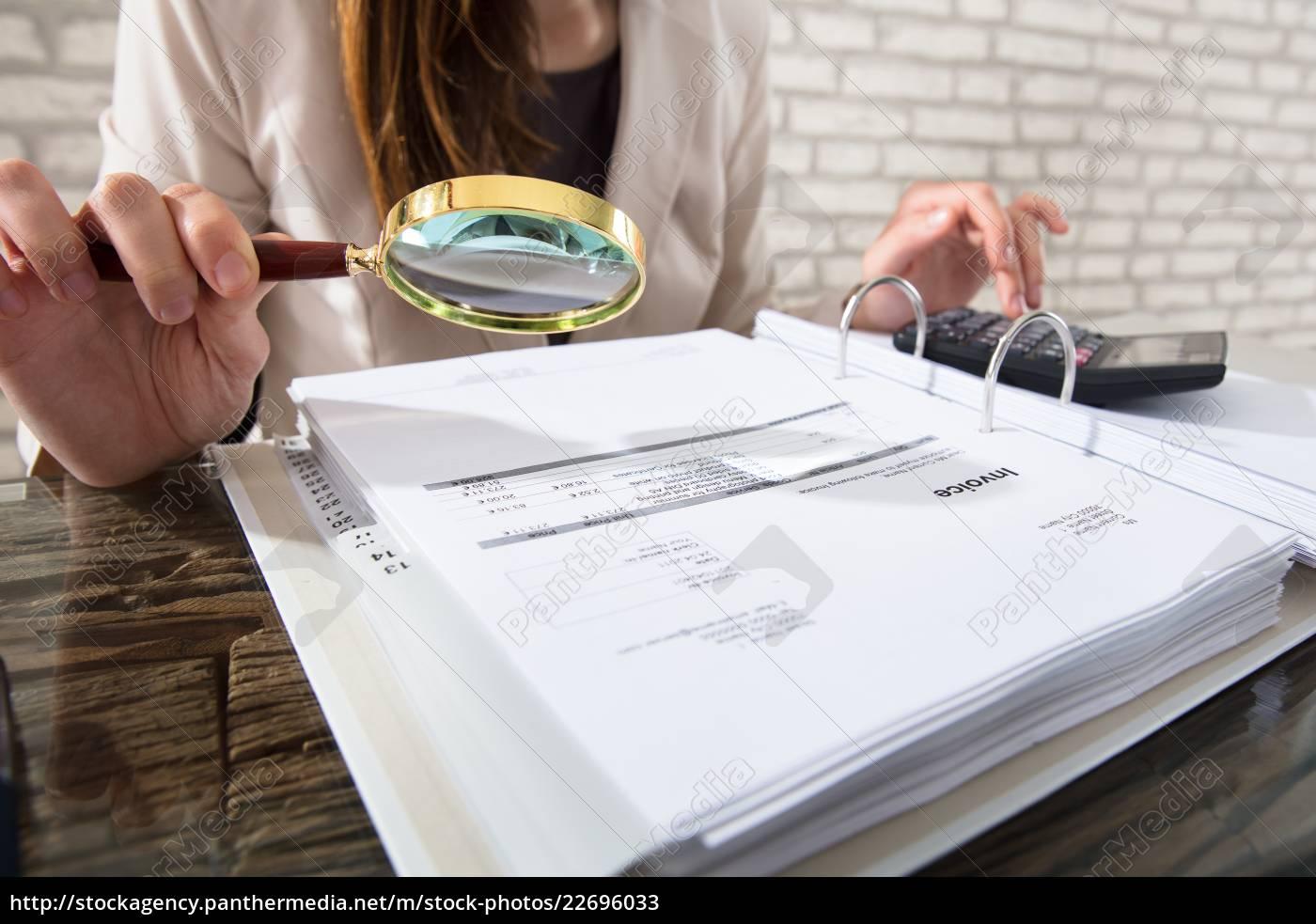 businesswoman, examining, invoices - 22696033