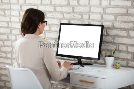 businesswoman, using, computer, with, blank, screen - 22696925