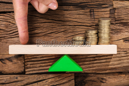 finger, balancing, stacked, coins, on, seesaw - 22696851