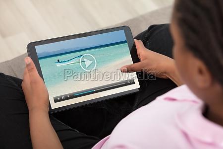 girl, watching, video, on, digital, tablet - 22696097