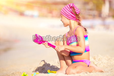 happy, girl, playing, on, the, beach - 22696133