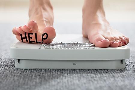 help, written, on, woman's, foot - 22696781