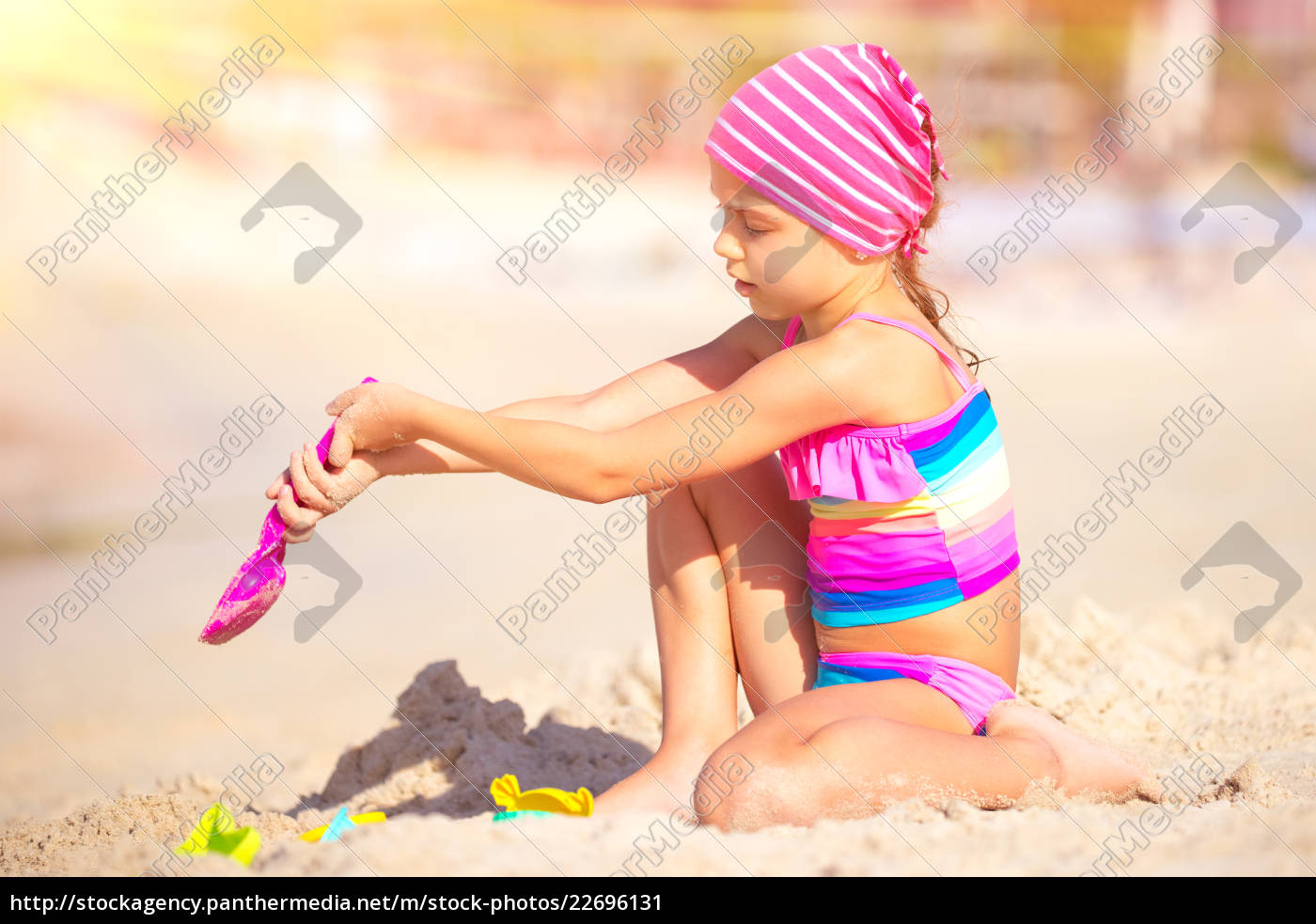 little, girl, playing, on, the, beach - 22696131