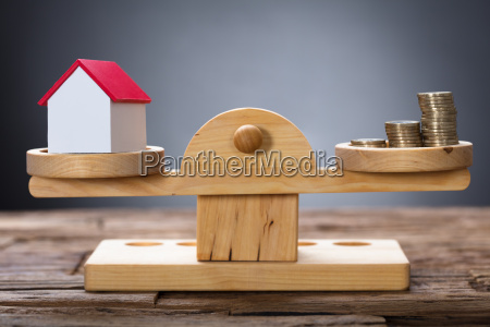 model, home, and, coins, balancing, on - 22696639