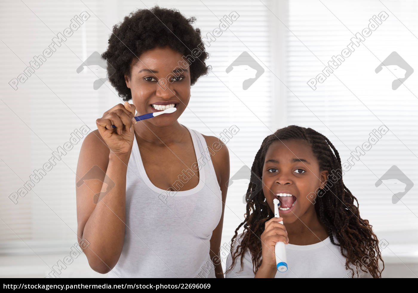 mother, and, daughter, brushing, their, teeth - 22696069