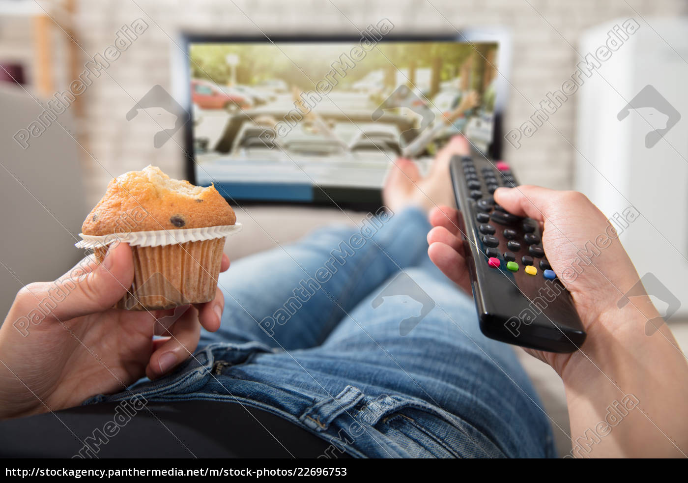 woman, holding, cupcake, and, remote, control - 22696753