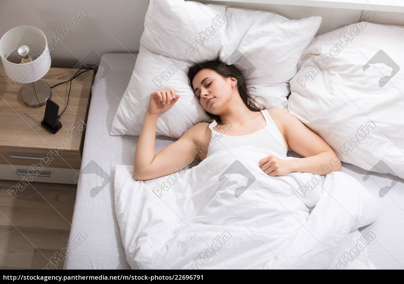 woman, sleeping, on, white, bed - 22696791