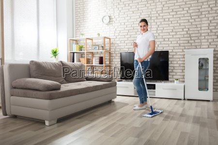 young, woman, cleaning, the, hardwood, floor - 22696743