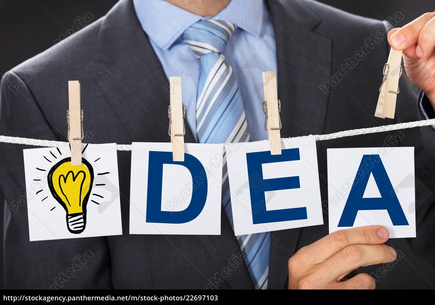 businessman, pinning, idea, cards, on, clothesline - 22697103