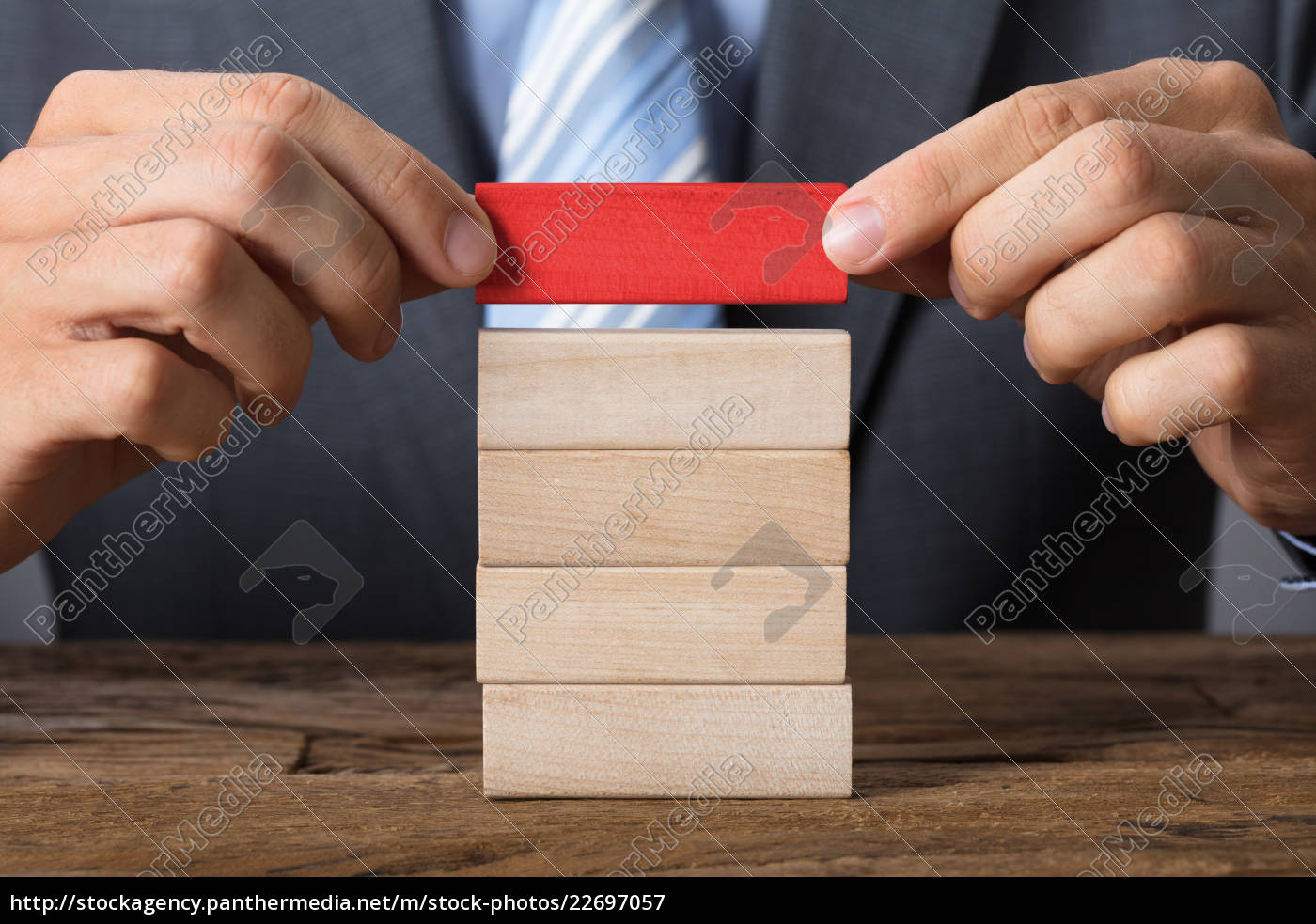 businessman, placing, red, block, on, wooden - 22697057