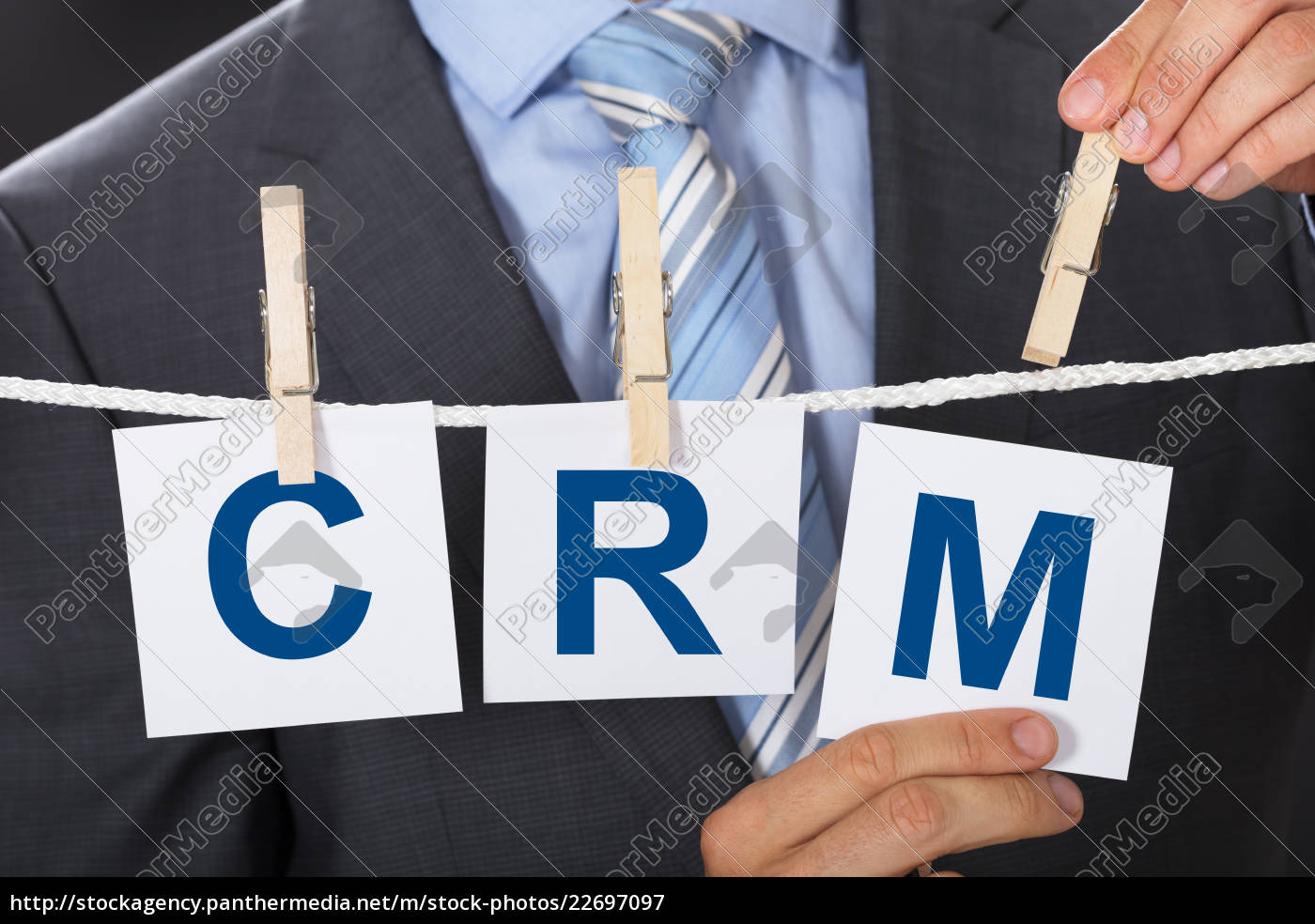 midsection, of, businessman, pinning, crm, papers - 22697097