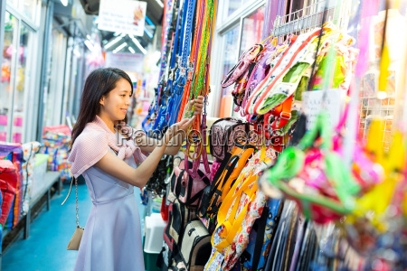 young woman shopping in street market