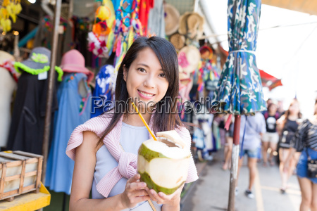 young woman shopping at street and