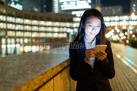 asian, businesswoman, use, of, mobile, phone - 22700475