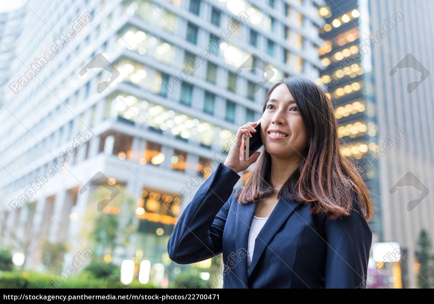 businesswoman, discuss, on, cellphone - 22700471