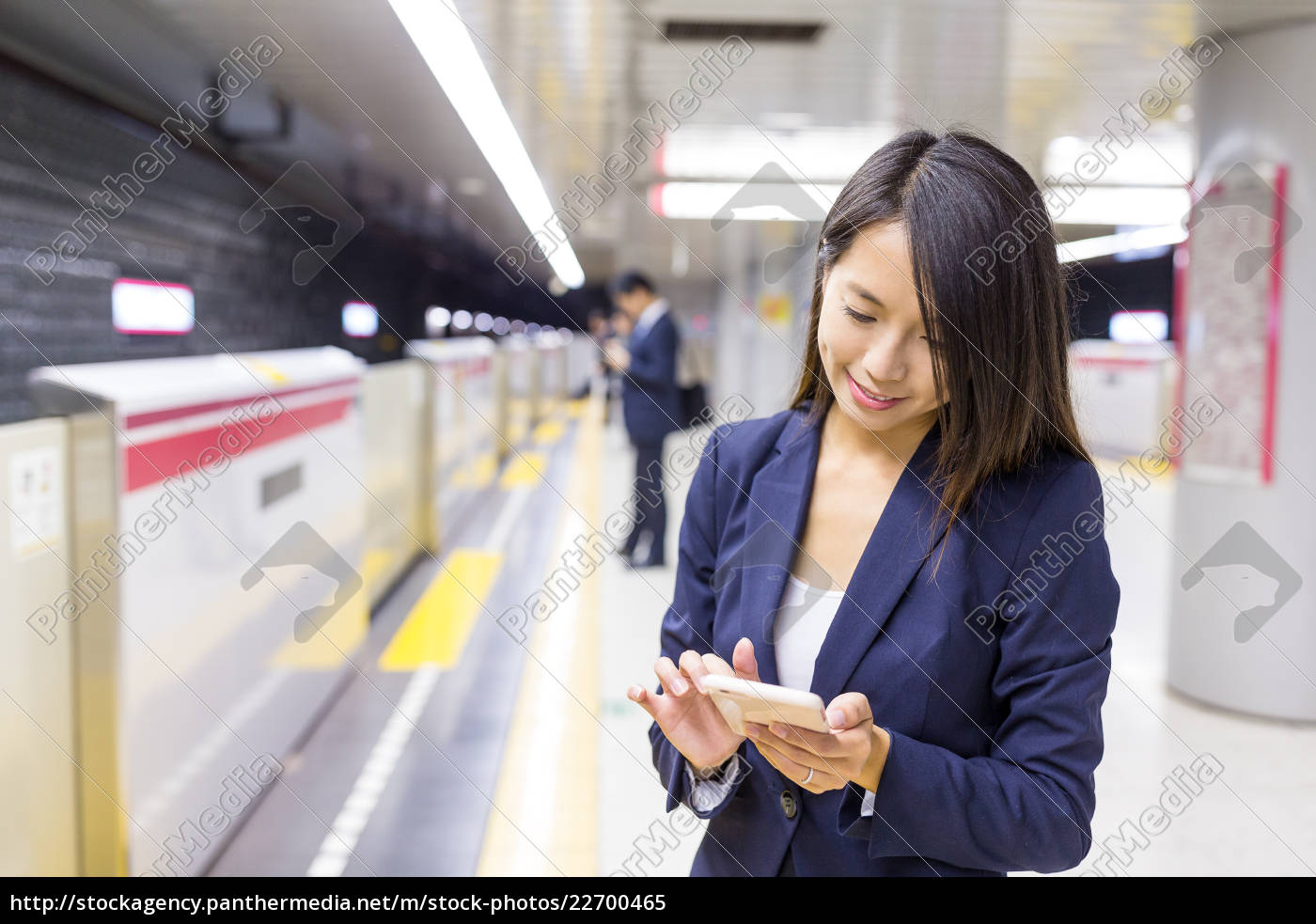 businesswoman, use, of, cellphone, in, train - 22700465