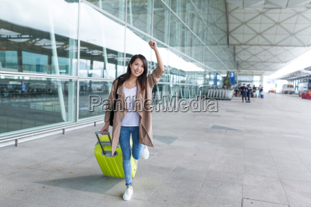excited, woman, go, travel, with, passport - 22700507