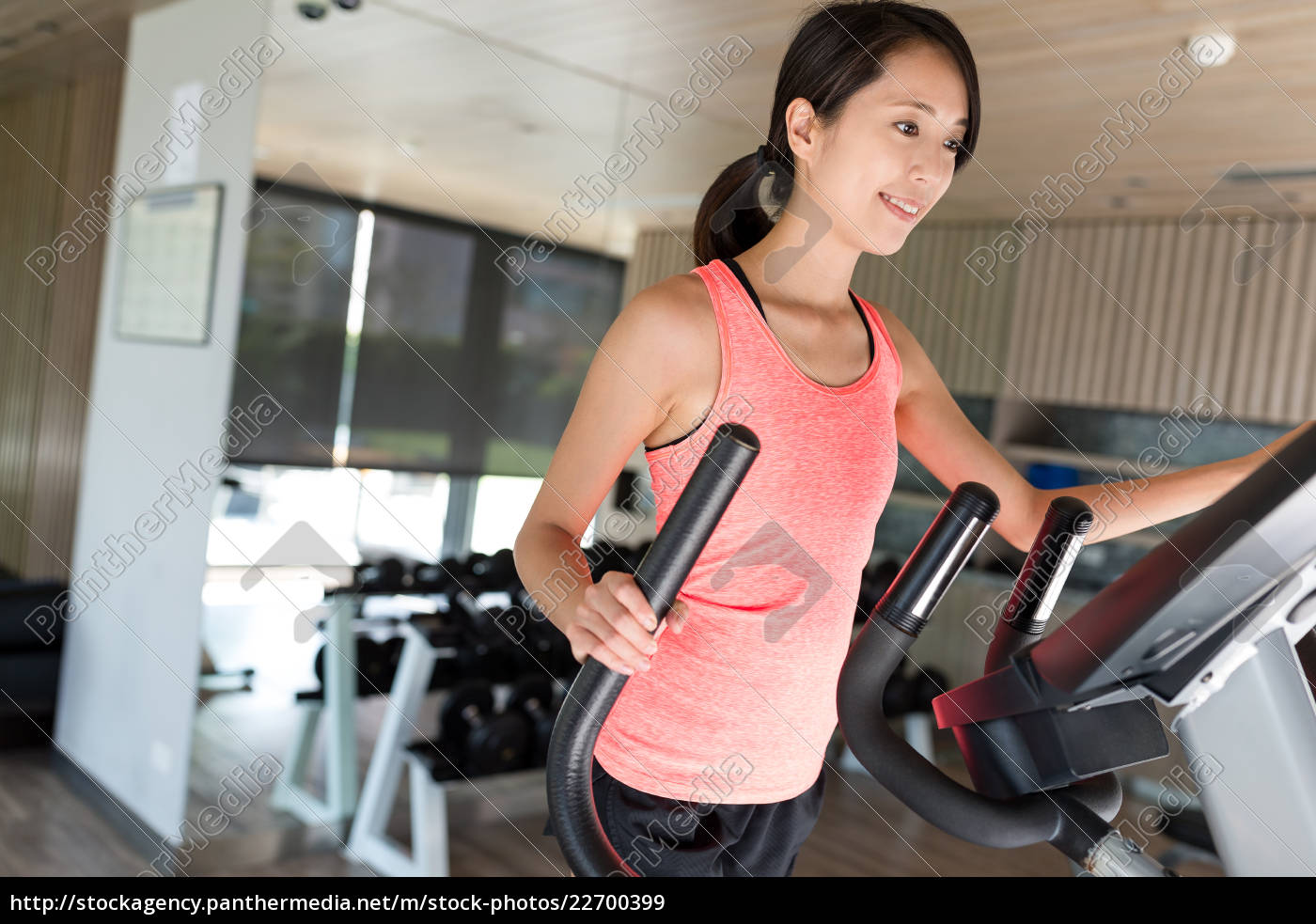 sport, woman, training, on, elliptical, machine - 22700399