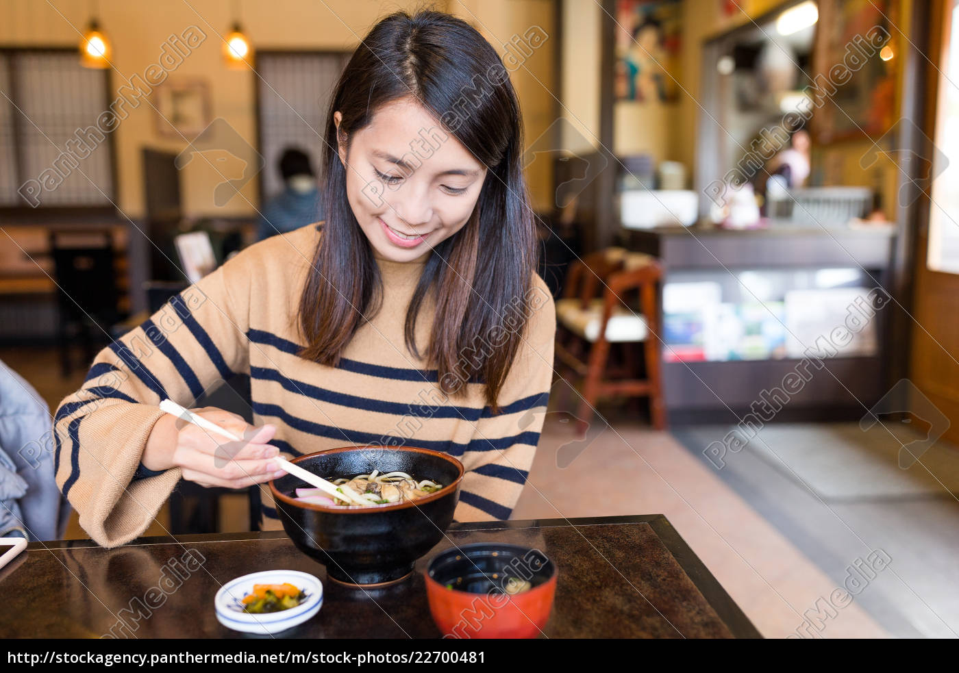 woman, enjoy, udon, in, japanese, restaurant - 22700481