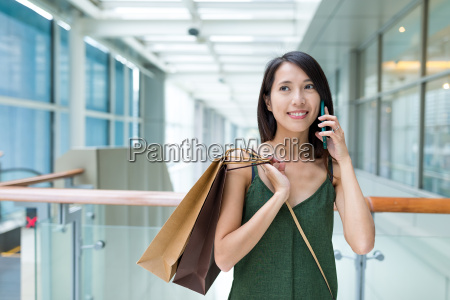 woman, go, shopping, and, talk, to - 22700539