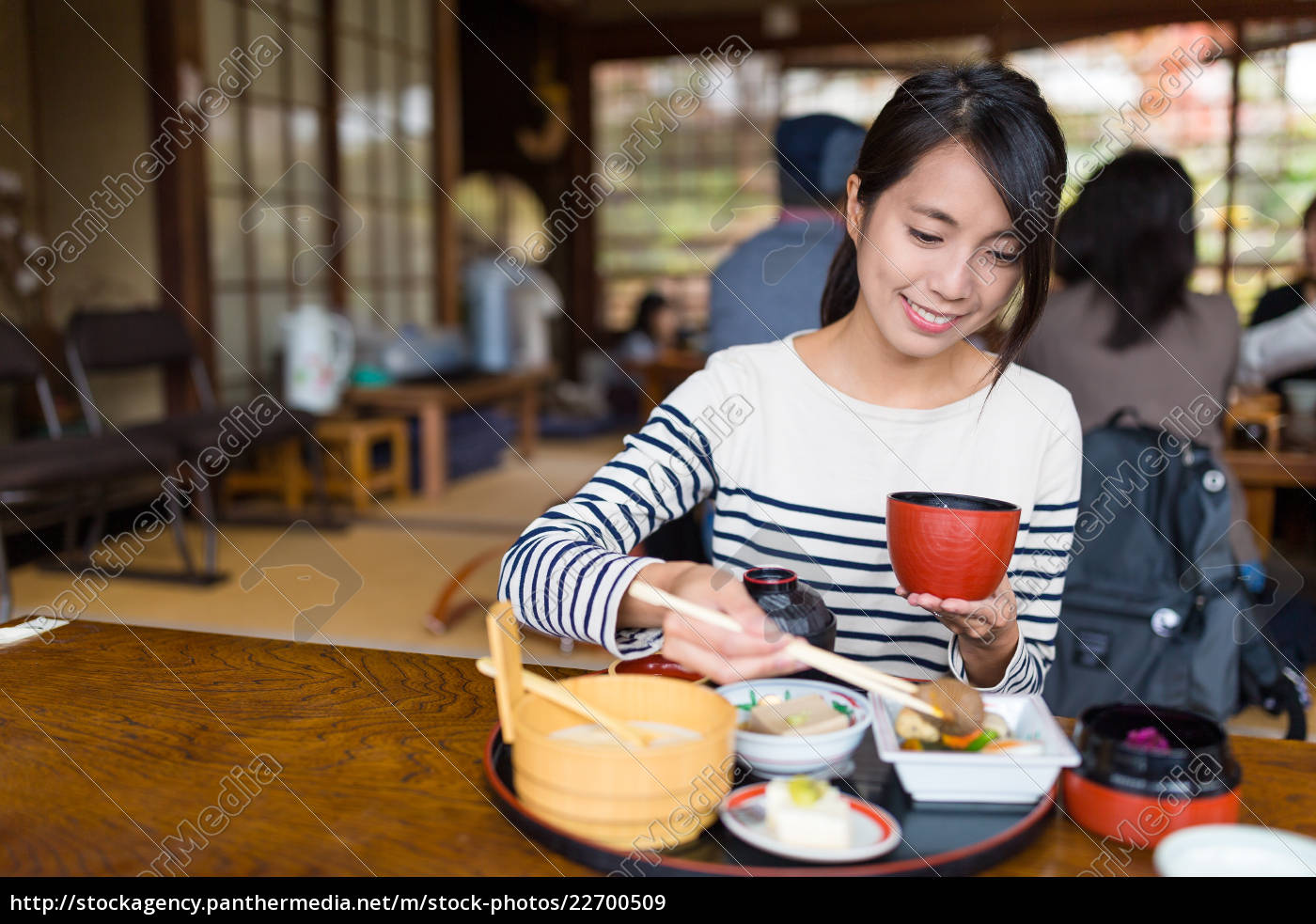 woman, having, japanese, meal, inside, a - 22700509