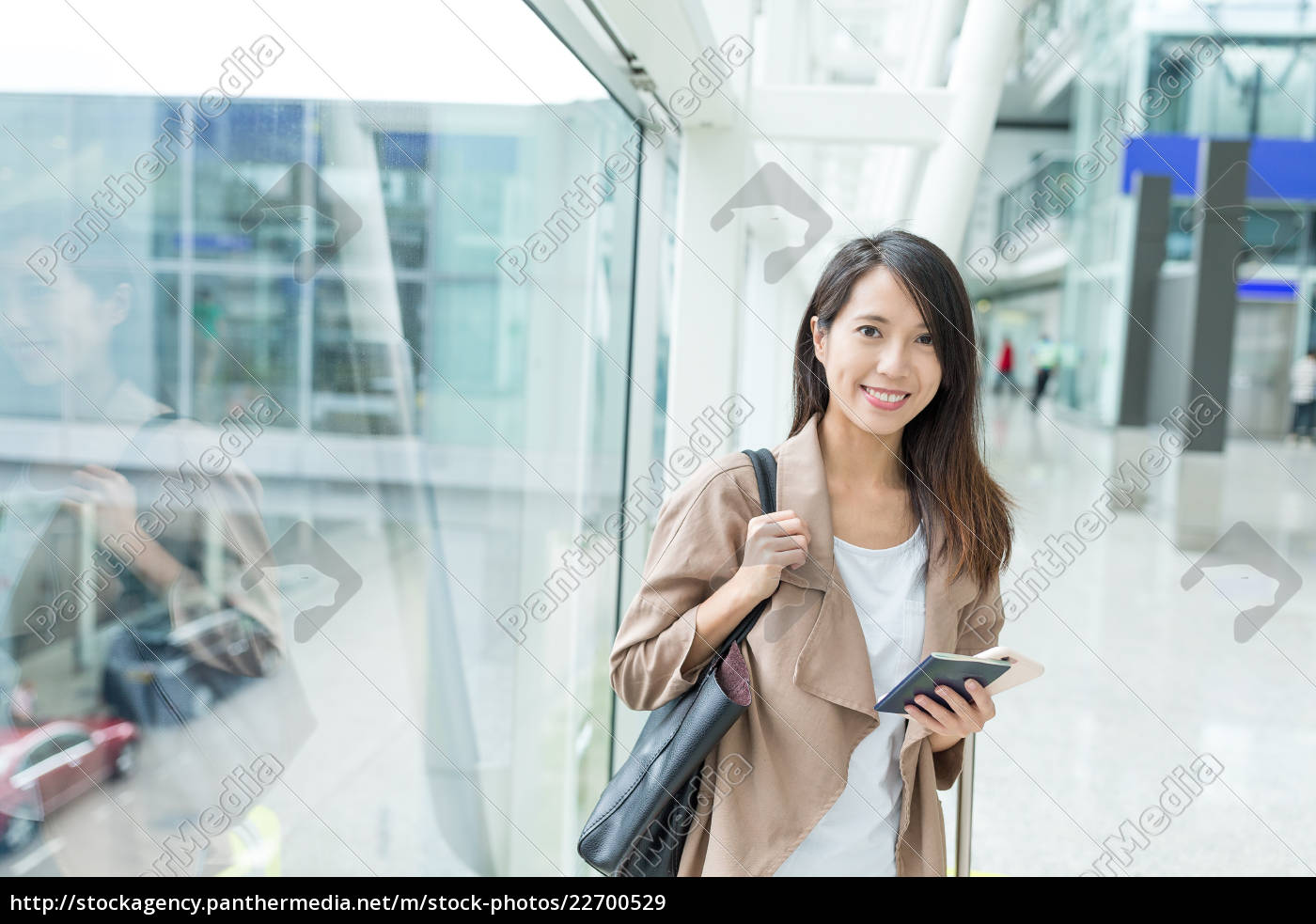 woman, holding, cellphone, and, passport, in - 22700529