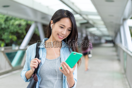 woman, listen, to, music, with, mobile - 22700667