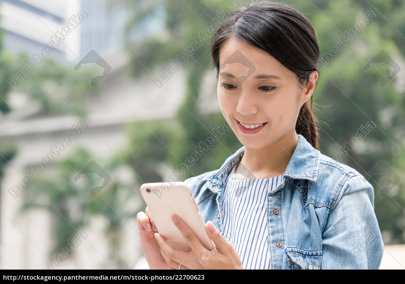woman, looking, at, mobile, phone - 22700623