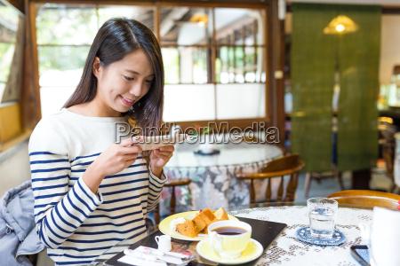 woman, taking, photo, on, her, breakfast - 22700485