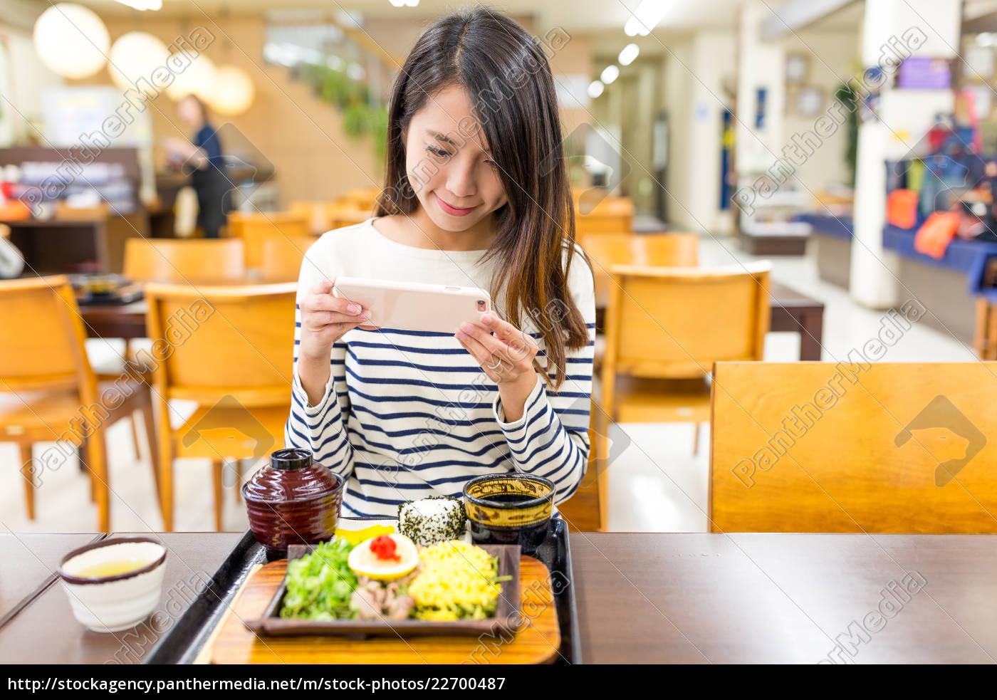 woman, taking, photo, on, japanese, cuisine - 22700487