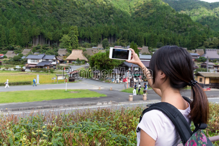 woman, taking, photo, with, cellphone, in - 22700437