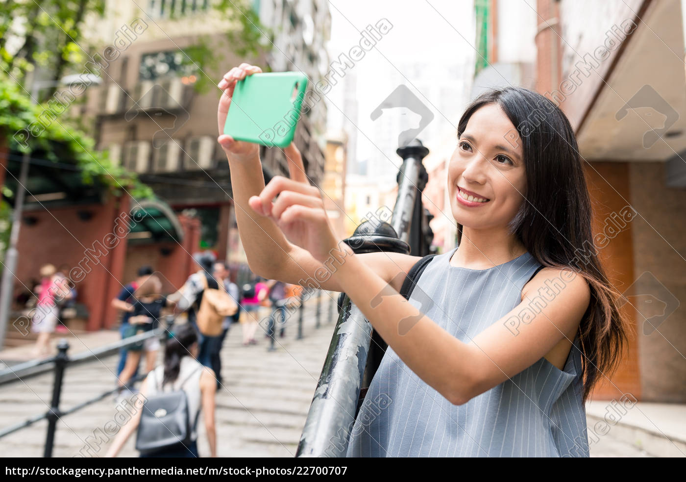 woman, taking, photo, with, cellphone, in - 22700707