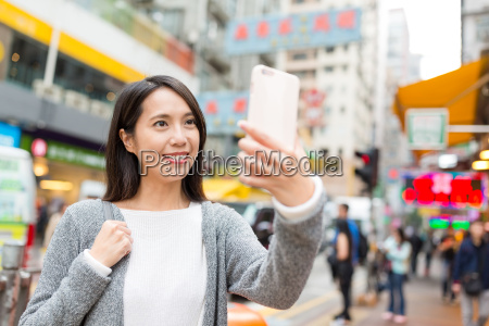 woman, taking, selfie, by, mobile, phone - 22700541