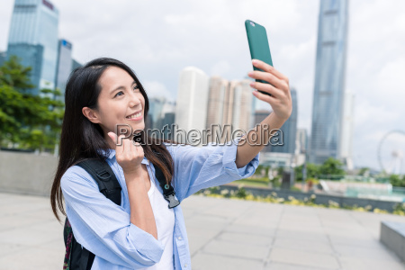 woman, taking, selfie, with, mobile, phone - 22700551