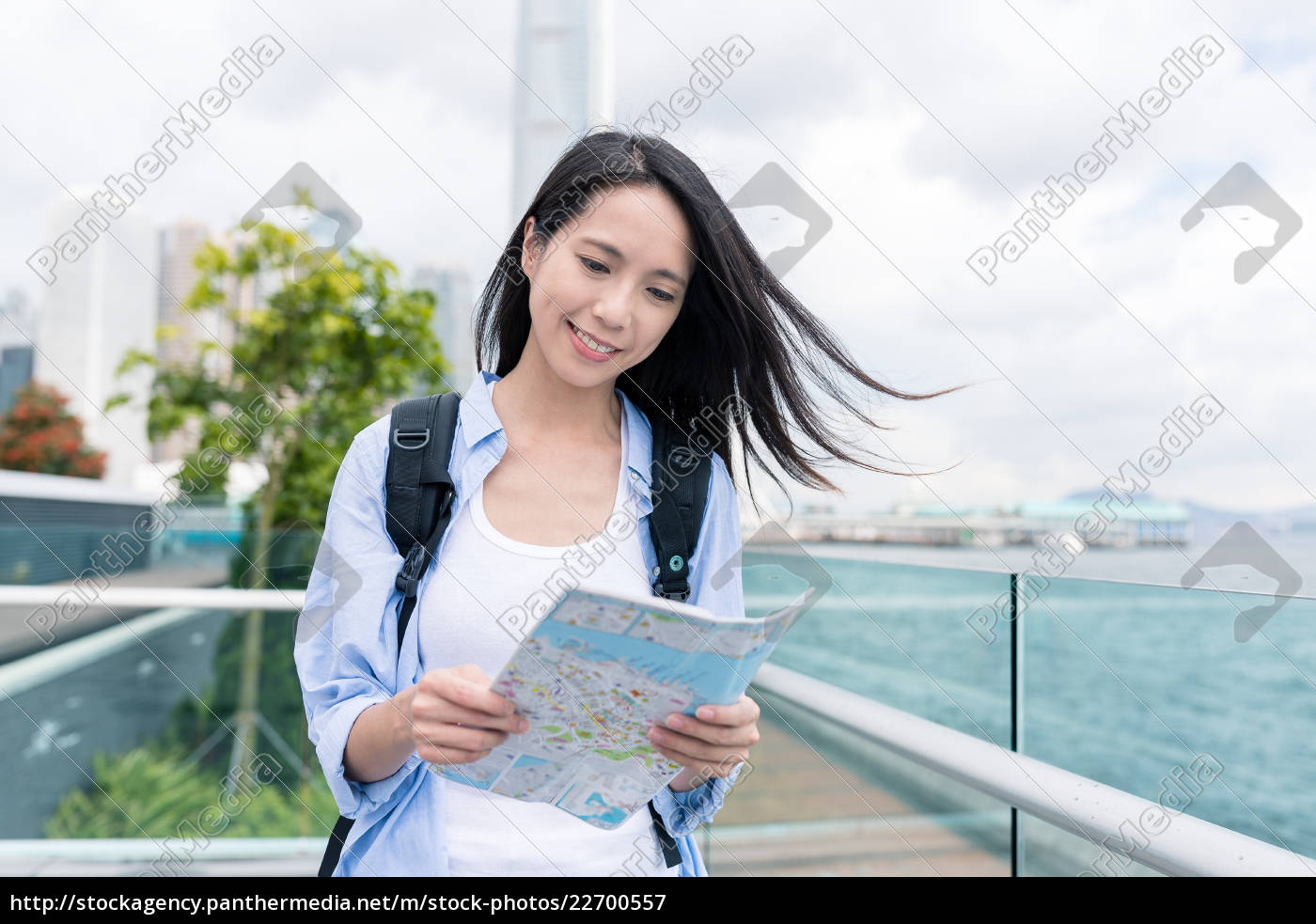 woman, use, of, city, map, in - 22700557