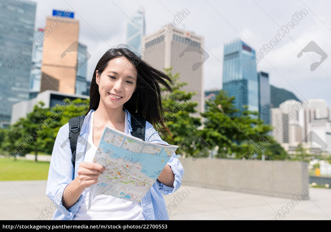 young, woman, use, of, map, in - 22700553